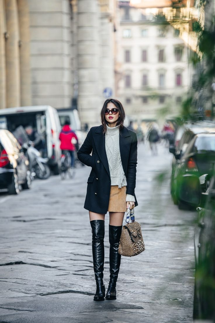 Patent boots will always look great worn with a mini skirt and knitwear, as seen here worn by Doina Ciobanu. Add an oversized double breasted blazer to accurately recreate this unique look. Jumper: Coach, Coat: Zara, Skirt: Showpo, Boots: Stella McCartney, Bag: Hill & Friends.
