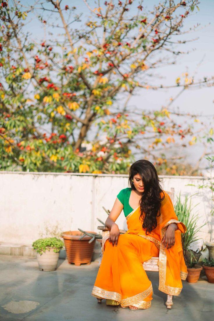 Orange chiffon saree with gold gotta patti border. Saree by Nafisa Rachel William