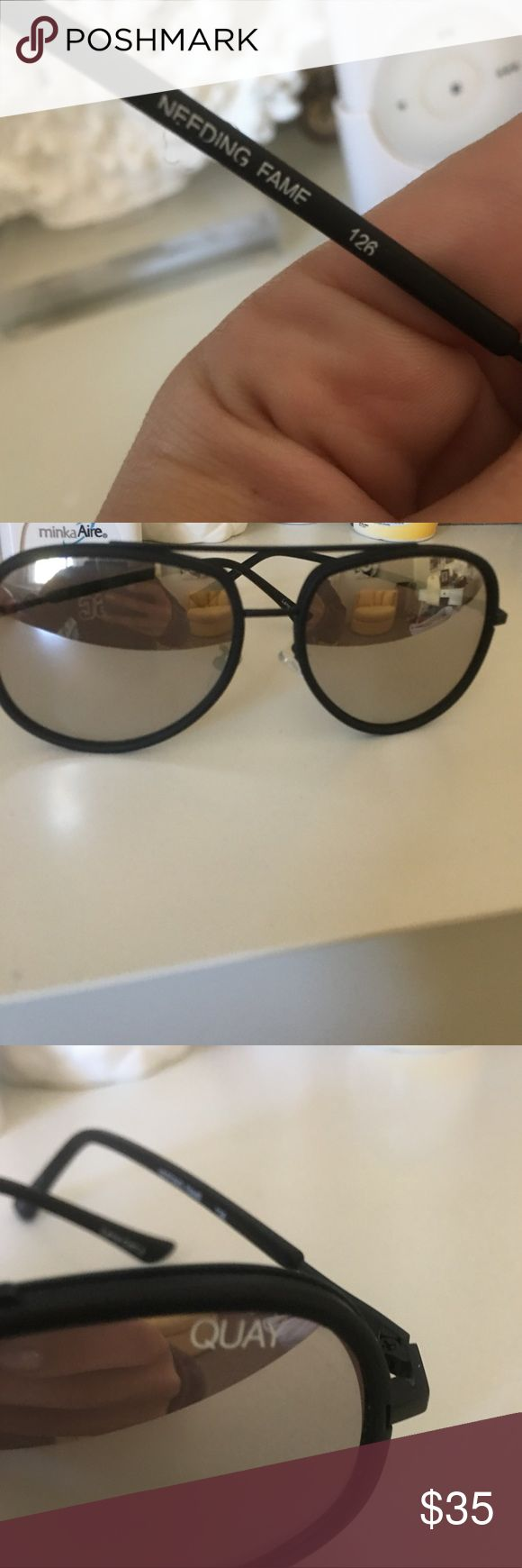 Quay glasses Barely used Quay sunglasses tinted and great to wear in the sun. Reflective lenses and matte black frames Quay Australia Accessories Sunglasses
