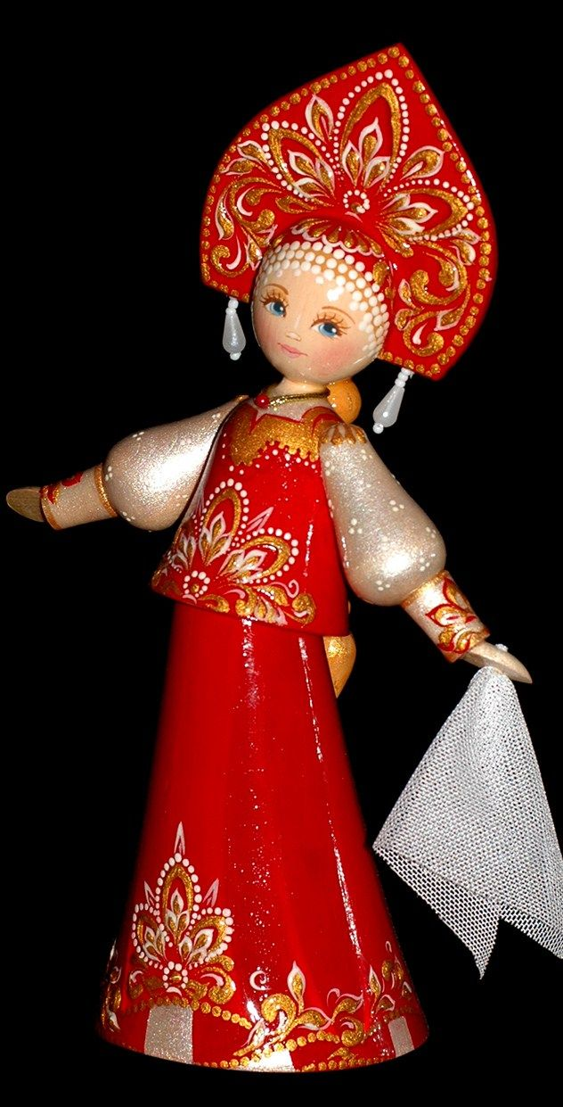 A wooden painted doll is one of the traditional Russian toys. Dancing beauty in the Russian national attire.