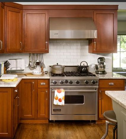 subway tile backsplash, cherry kitchen cabinets, stainless steel appliances
