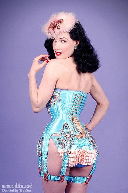 Dita Von Teese in a Dark Garden corset embellished by Catherine D'Lish. Corset: Arch Rival Custom Corset by Dark Garden Model: Dita Von Teese Photo: Danielle Bedico