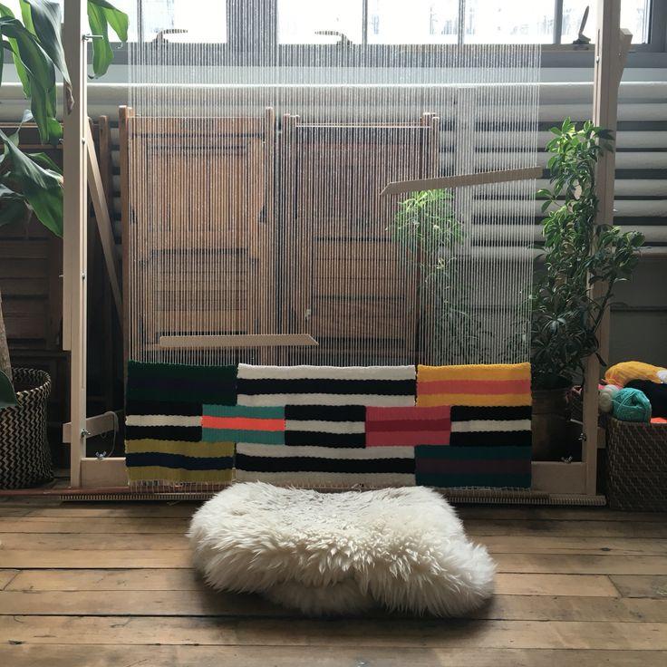 Maryanne Moodie weaving on the loom I her Brooklyn studio
