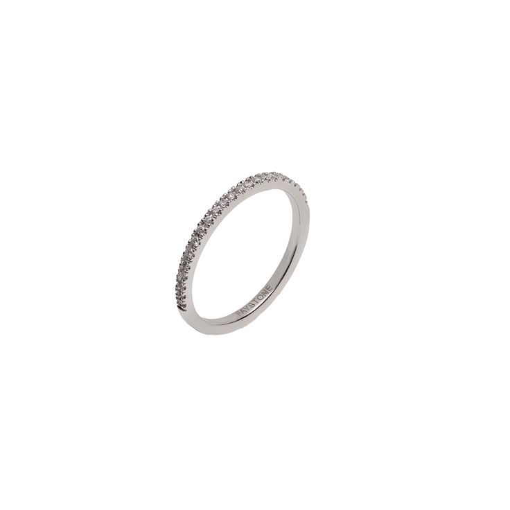 A chic 18K white gold half band composed of sparkling brilliant cut diamonds, the Orion white gold ring is inspired by the stars that shine bright like diamonds in the sky.
