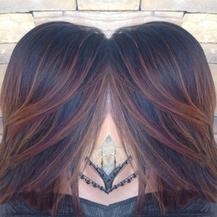 Copper red highlights on black hair