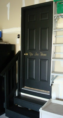 paint my garage stairs black& put a cute quote on the door. It would hide the marks on the door  that are easily seen on the white.