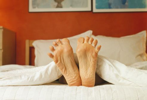 Google Image Result for http://img.webmd.boots.com/dtmcms/live/webmd_uk/consumer_assets/site_images/articles/health_tools/back_pain_slideshow/getty_rm_photo_of_feet_in_bed.jpg