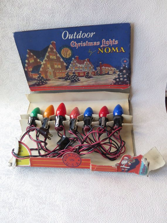 1930s Christmas. https://www.etsy.com/listing/259286176/noma-christmas-lights-working-condition