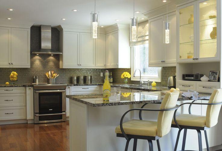 White custom cabinetry with Pegasus granite countertops. Part of main floor renovation of 1980's Mississauga home. Find me on Houzz, http://www.houzz.com/pro/carolinemckaydesign/caroline-mckay-design or my website www.carolinemckaydesign.com  #oakville #interiordesign, ,#whitekitchen #mississauga #yellowaccents #kitchenhardwoodfloor