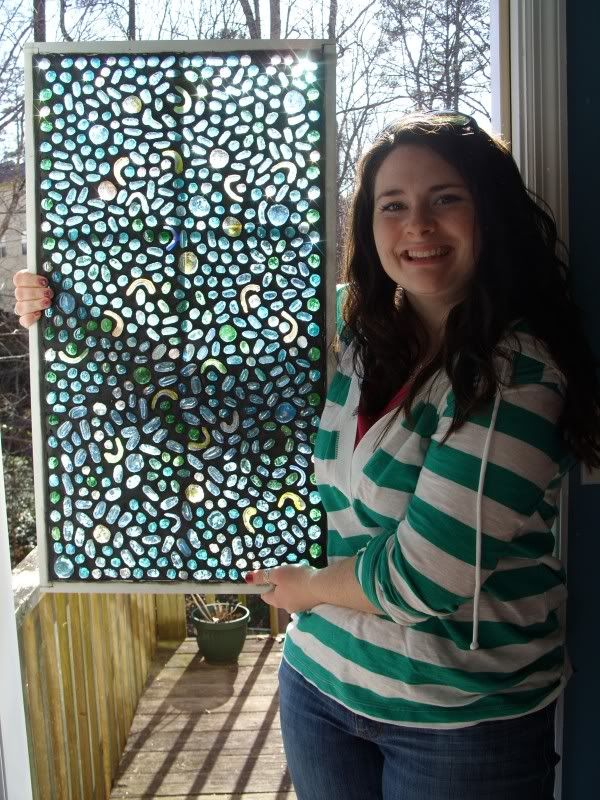 mosaic window made with glass pebbles and grout