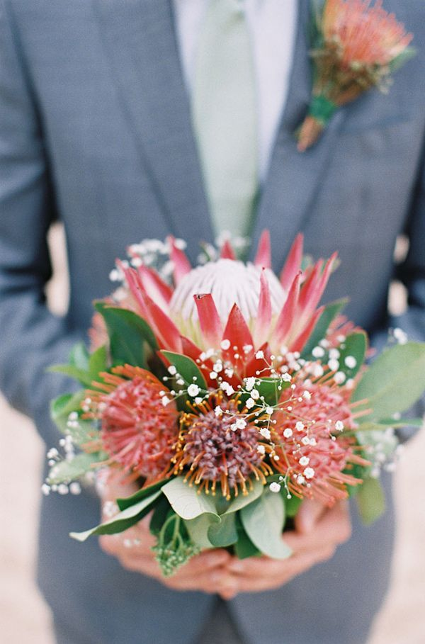 protea and pincushion floral arrangement, photo by Feather and Stone http://ruffledblog.com/south-african-destination-elopement #flowers #weddingflowers