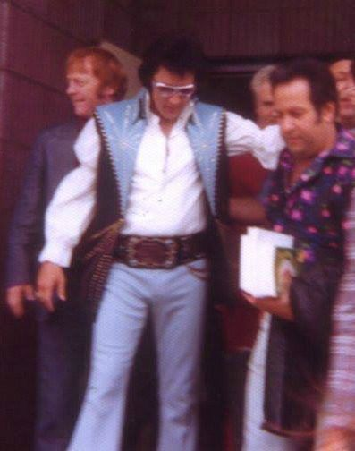 """Elvis and some of the Memphis Mafia. In this photo is Red West and Joe Esposito, both were very good friends of Elvis'. Unfortunately Elvis and Red West fell out just months before his death. Red was fired because he was getting very heavy handed with people trying to get to Elvis. He then decided to write a book with his cousin and another member of the MM called """"Elvis What Happened?"""". This crushed Elvis, he felt betrayed."""