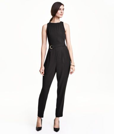 Sleeveless jumpsuit in a slightly textured woven fabric. Fitted bodice with cut-out section at back and gold-colored buttons at back of neck. Seam at waist, tapered legs with pleats, and concealed side zip. Belt with a metal buckle. Unlined.