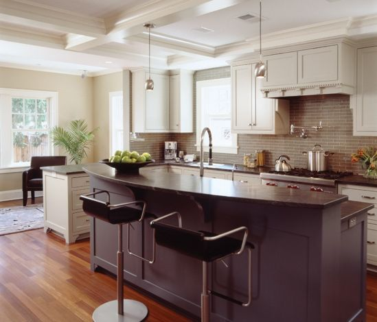I like how this kitchen extends into a seating area/small family room // Design by Rehkamp Larson