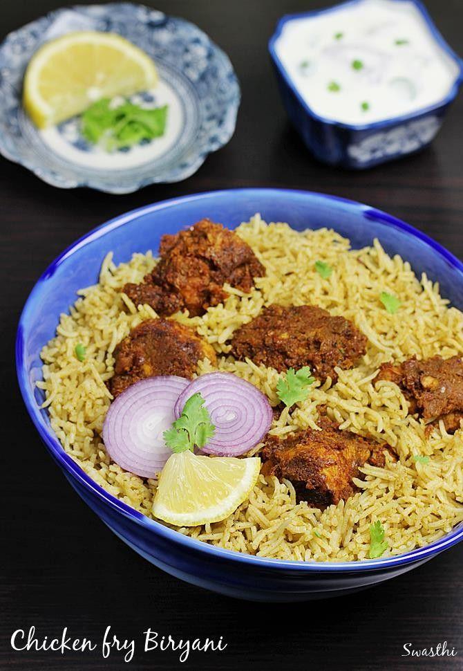 chicken fry biryani - andhra restaurant style dum cooked biryani rice with spicy chicken fry. It is served with salan & onion raita