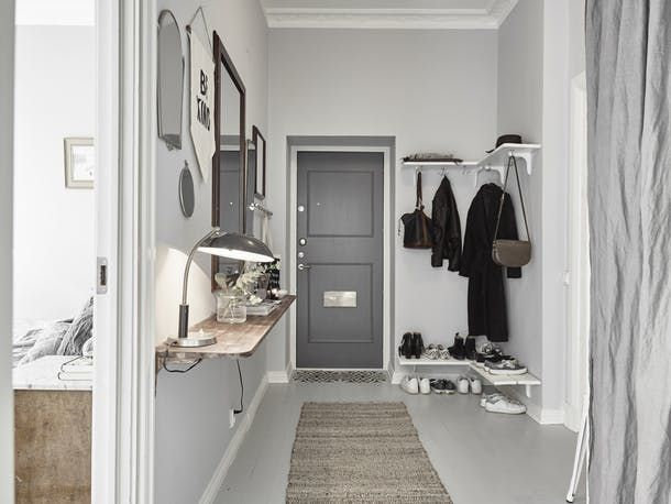 Living in a little space, without a dedicated entryway (or even a coat closet) doesn't have to mean having purses and keys and boots and coats strewn all over the place