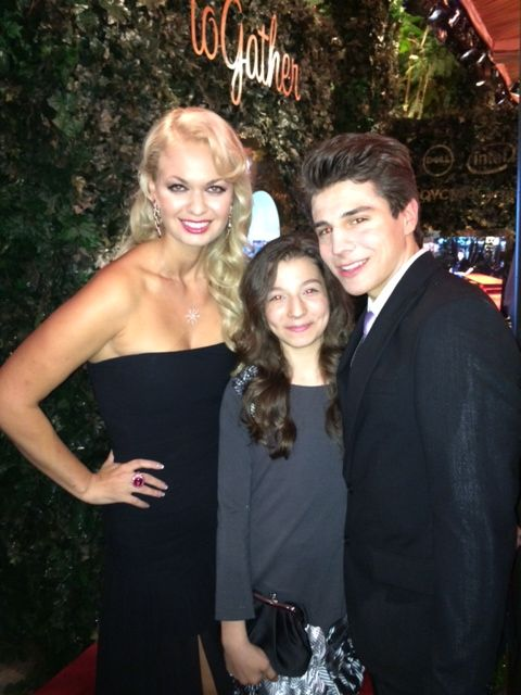 Actors Michael Grant and Angeline Rose Troy surround 'The Goldbergs' Stephanie Katherine Grant at the QVC pre-Oscar soiree at the 4 Seasons Hotel in Beverly Hills, CA