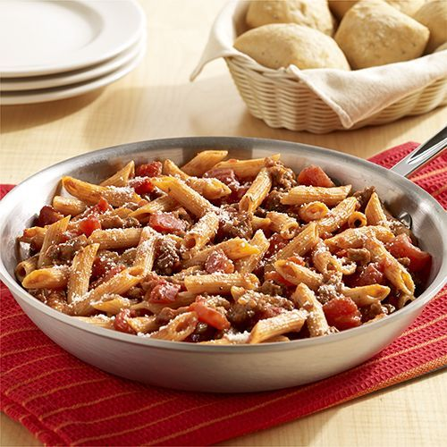 One-Skillet Italian Sausage Pasta: Easy pasta recipe with Italian sausage, tomatoes and pasta all cooked together in one skillet, then topped with Parmesan cheese.  (5 ingredients)