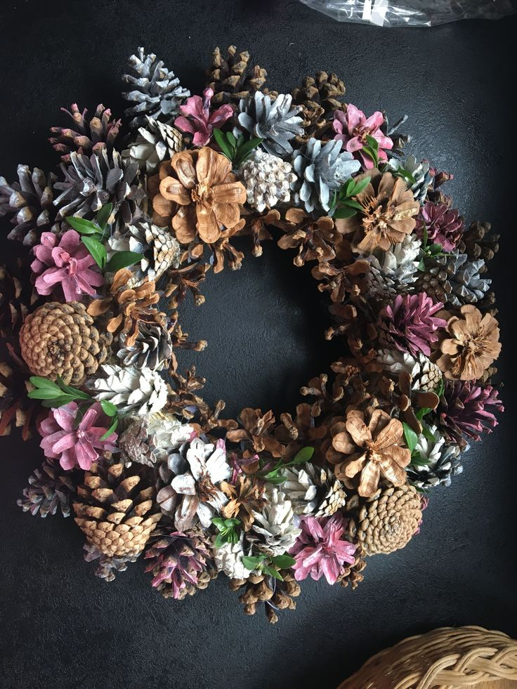This unique pine cone wreath in shades of blue, gr…