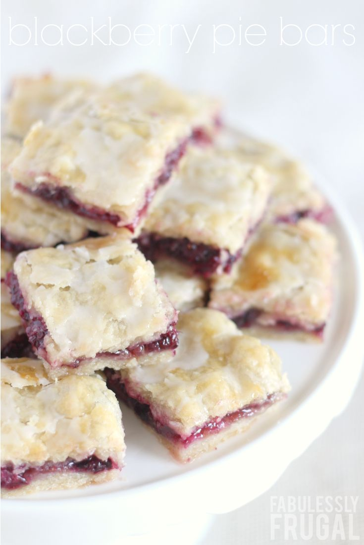 Blackberry Pie Bars Recipe: This Blackberry Danish Bar recipe is a keeper! I'm not usually a big fan of berry desserts and pies, but I love these Danish pie bars! Of course, the crust is my favorite part. It is flaky and tender, yet thick enough that you can eat the bars with your hands. No fork necessary. Basically, the sweet berry filling and tender, flaky crust are magical together. Yum!