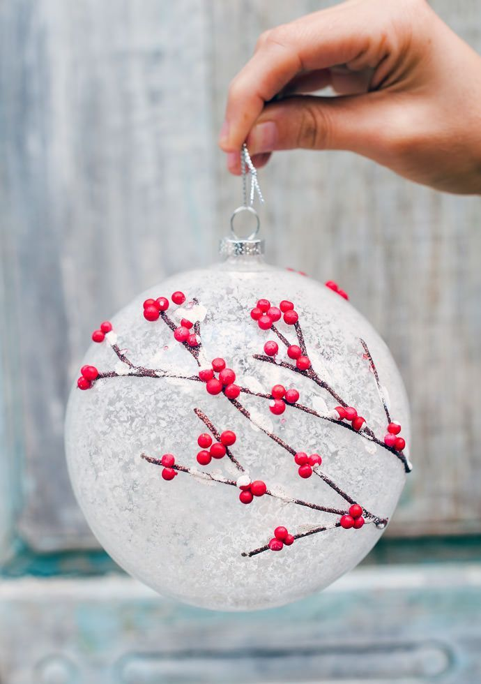 Frosted holly ornament adds a breath of whimsy to the Woodland Ornament Set from…
