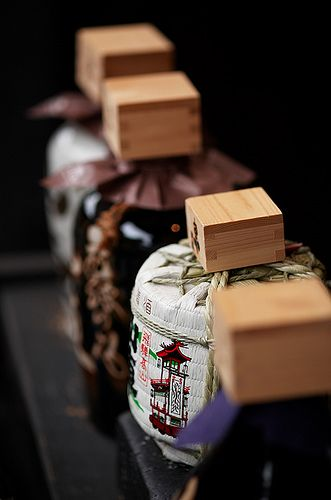 Small Japanese Sake barrels ~~  The wooden cups atop them gives a sense of scale
