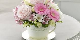 Flowers inside baskets, mugs, vases or boxes can make lovely gifts for mothers. Florists may decide to sell these.