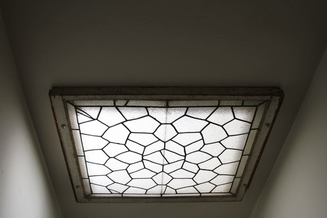use a vintage stained glass window as a decorative cover to a skylight as seen in Jonah Adler's House Tour | Apartment Therapy