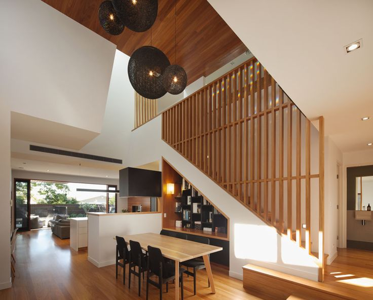 kalka small lot home. Voluminous void space with feature pendant lighting, blackbutt timber screening, angular lines, timber ceiling, built in bookcase. Shaun Lockyer Design