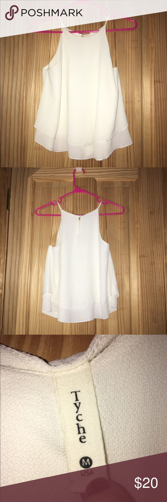 White layered tank Size: Medium. White layered tank top from Apricot Lane. Has a decorative button to secure the shirt. Worn once. Tyche Tops Tank Tops