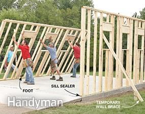 Framing a Garage: Stand the walls. Get the plans: http://www.familyhandyman.com/garage/framing-a-garage/view-all