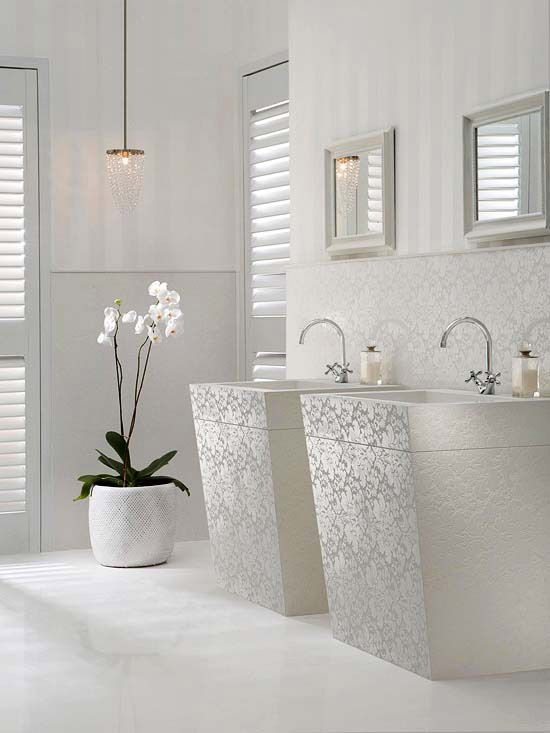 Add signature flourish, intrigue, and even texture to an all-white bath. In this unique space, a quartz tile surface is embossed with a subtle wash of lace pattern that dances in the natural light.