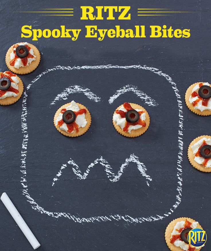 These RITZ Spooky Eyeball Bites are a Halloween snack the kids will love! Mix cream cheese and mozzarella until blended, spreading onto crackers. Place in a single layer on a baking sheet, adding a spoonful of sauce and an olive. Bake until warmed and use a toothpick to draw lines in the sauce. Boo!