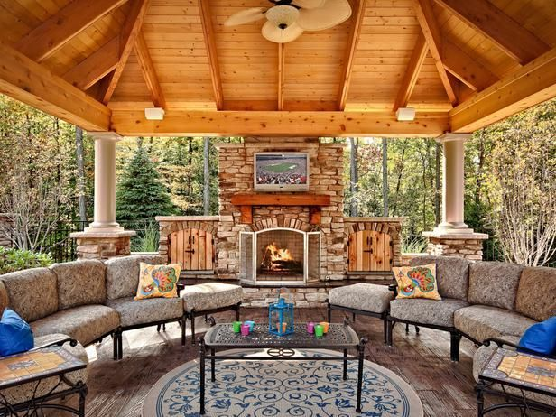 Thanks to a fireplace and a ceiling fan, this outdoor room can be used year-round.