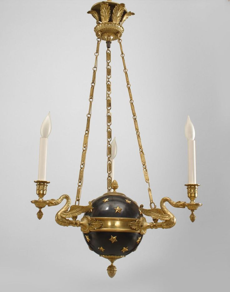 French Empire style (20th Cent) ebonized globe form chandelier with applied gilt stars and 3 swan form arms with an acorn finial bottom and suspended by 3 chains