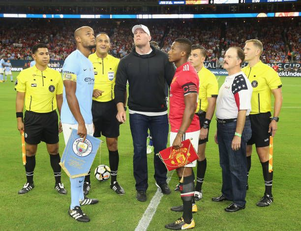 Captains Antonio Valencia of Manchester United and Vincent Kompany of Manchester City perform the toss ahead of the preseason friendly International...