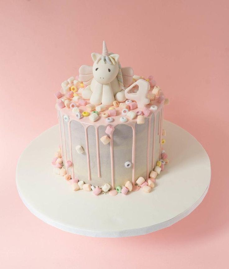White unicorn drip cake