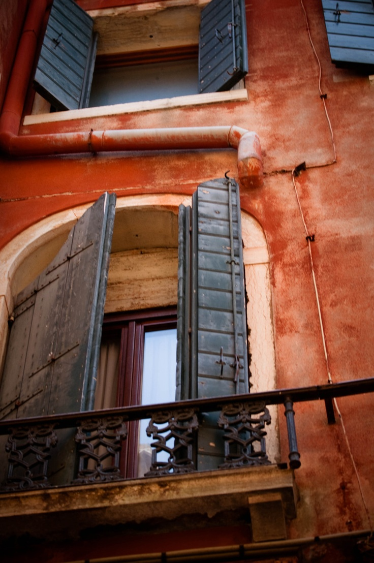 While wandering the streets of Venice, I looked up and saw a old Italian man looking out his window. He smiled at us and waved as we walked by looking at him reminded me of my papa who passed away 20 years ago when i was three. My camera battery died so no pic.