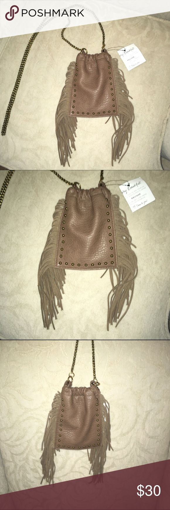 NWT! Dolce Vita cross body fringe bag in taupe This is such a great little bag for a shopping trip or a festival. Summer must have. Large enough to hold a phone (not iPhone plus) credit cards and a lip gloss DV by Dolce Vita Bags Crossbody Bags
