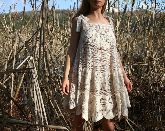 Crocheted circular lace tablecloth into dress.  http://ny-image1.etsy.com/il_570xN.191806185.jpg