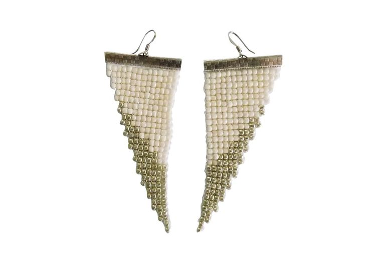 Handmade earrings made on a loom. A modern design combined with white and silver beads about 2 mm each.