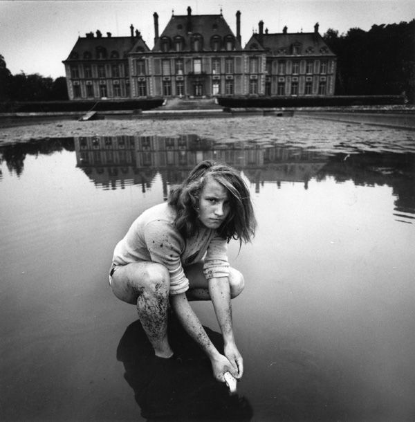 Arthur Tress  Girl Collecting Gold Fish, France  1974