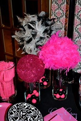Love the feather balls over the vases with pink and black gumballs.