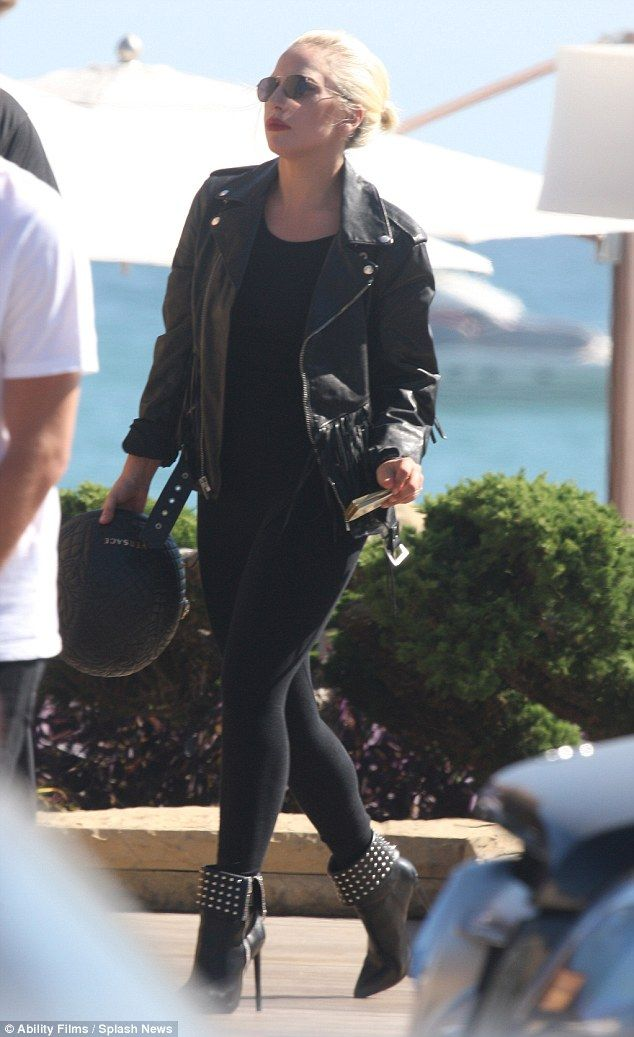 Biker babe: Perhaps taking inspiration from sultry Sandy on Grease, the star wore a pair of skin tight black pants with a black tank top and a leather motorcycle jacket