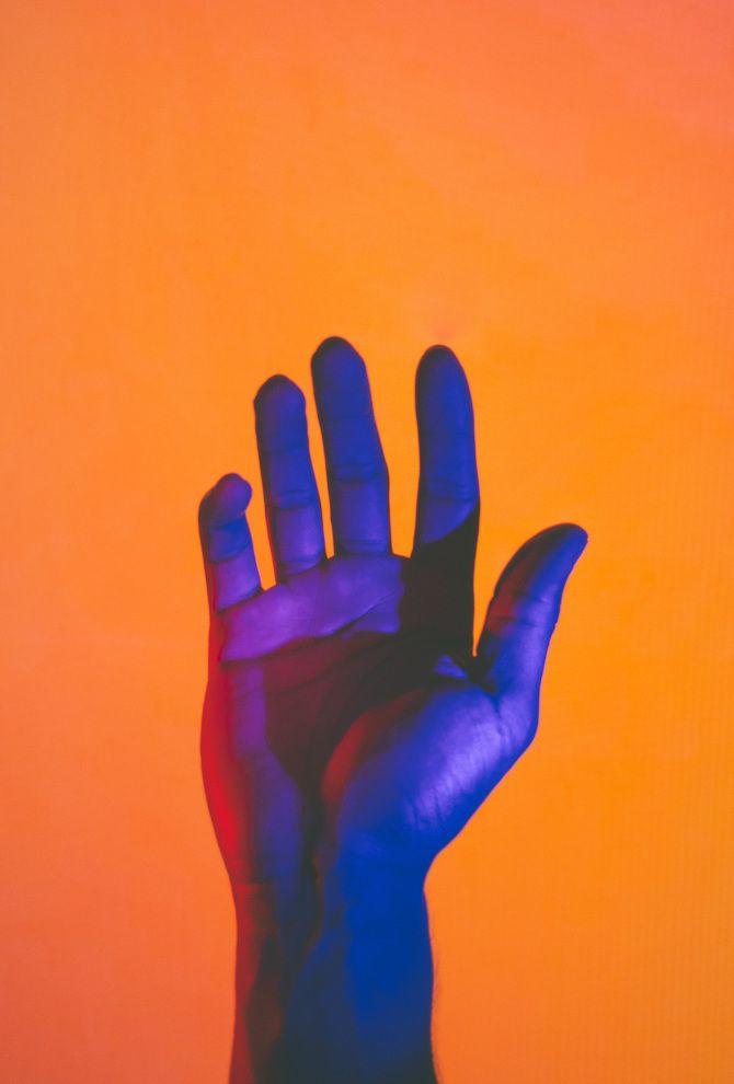 Hands Under Neon Lights