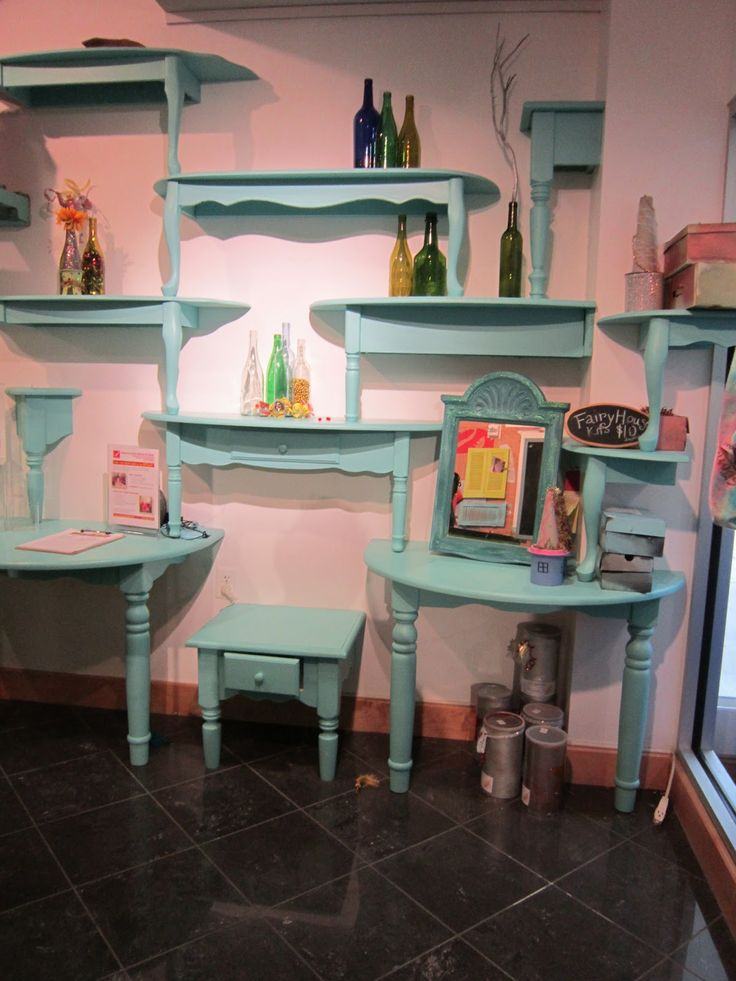 Table parts to a wall unit. Could be used for toy storage or to display vintage treasures. Dependent upon space and type of tables huge variety of possibilities.
