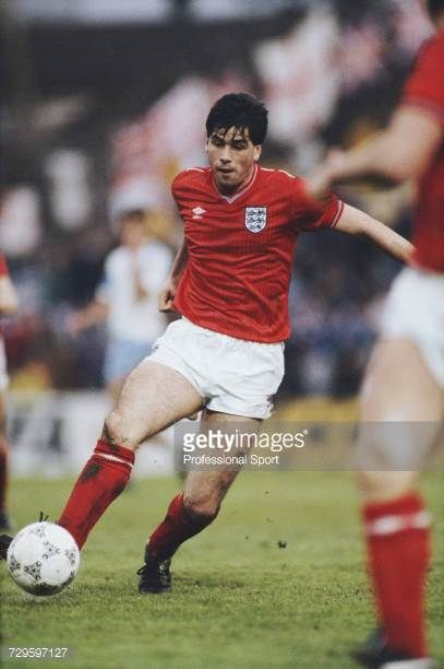 English footballer Neil Webb makes a run with the ball in an international friendly match between Israel and England at the Ramat Gan Stadium in Tel...