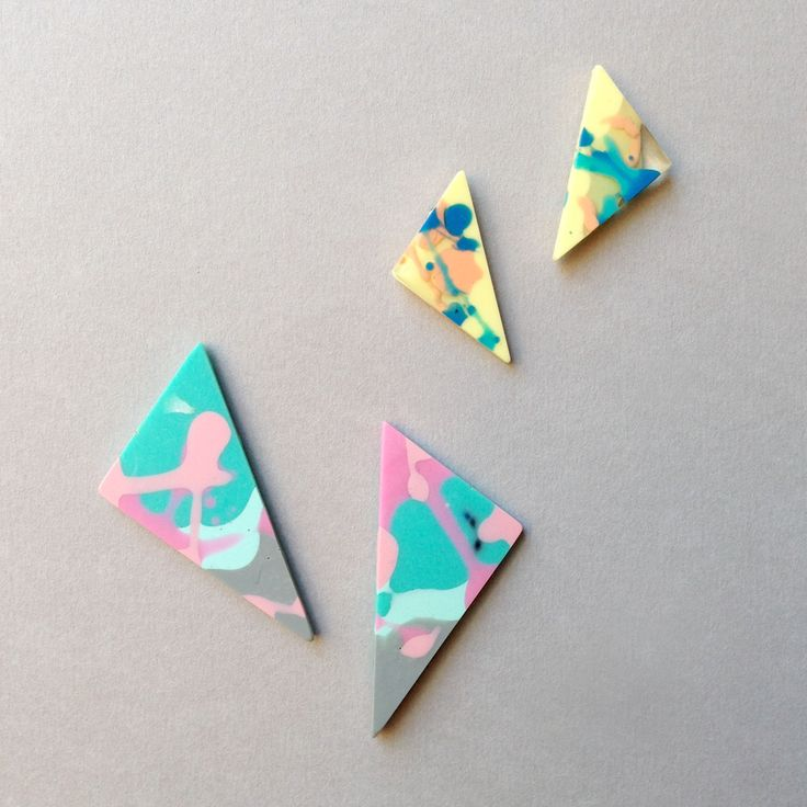"""multicoloured triangle studs . . . the translucent, opaque & metallic  resins are poured by hand making each pattern unique      * small - 3.5cm / 1.25""""     * large - 5.5cm / 2""""     * surgical steel posts (hypoallergenic)     * tiny air bubbles/pockets are part of the resin character  - handmade in Melbourne by Flock Curiosity Assembly  .  .  .  .  ."""