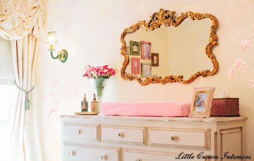 This fab gold mirror is the perfect accent in this sophisticated, chic nursery! #nursery