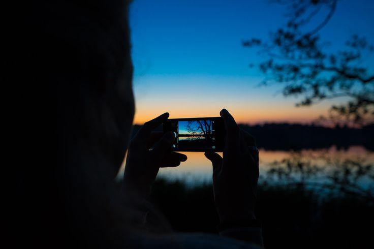 Girlfriend photographing sundown over Bagsværd Sø.